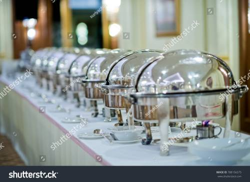stock-photo-scooping-the-food-buffet-food-at-restaurant-catering-food-788156575